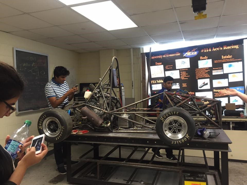 Students looking at the prototype of a racing car at the mechanical engineering lab at Valparaiso University in Valparaiso, Indiana.