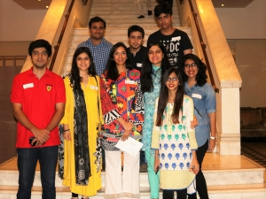 Saad Malik (front row, left, in red) joins fellow Competitive College Club members in Lahore.