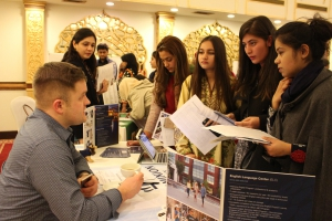 Pakistani students speaking to U.S. representatives at a college fair in Islamabad.