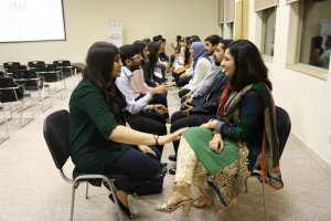 Alumni perfecting their elevator pitches during the speed networking round at Fulbright Connect in Lahore.