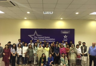 "Alumni in Lahore enjoy the screening of ""Armed with Faith""."