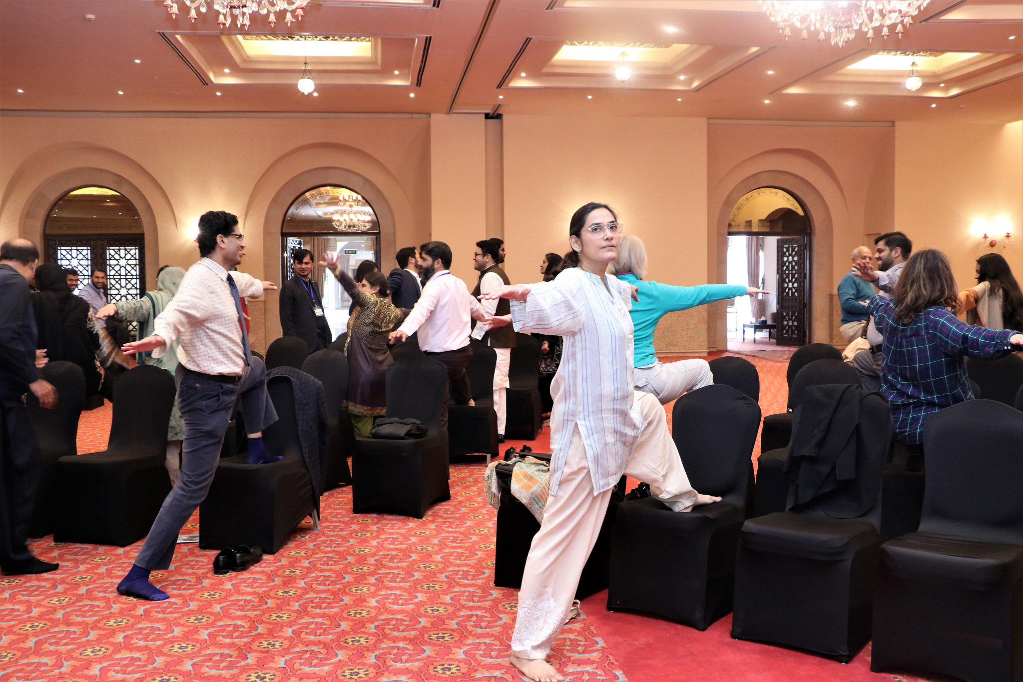 Participants enjoy yoga and meditation in a masterclass by Nadia Akram