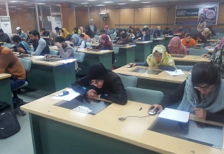 Students of University of Agriculture Faisalabad taking the GRE mock test