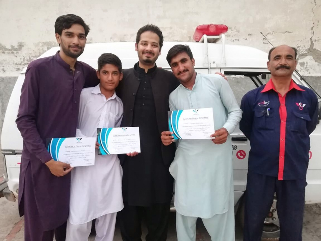 Usama with trainee's from Saving 9 Pind Begwal's Basic Health Unit