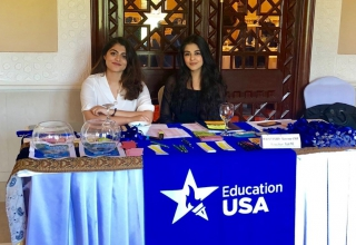 EdUSA's summer interns Amna and Alezeh assisting the staff at an event.